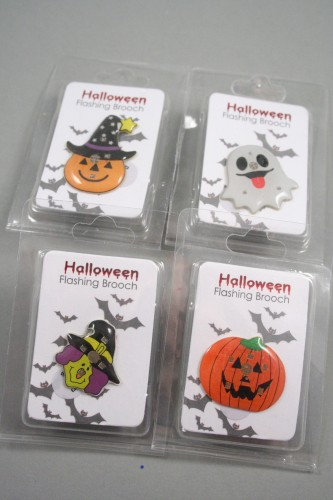 Clip Strip of 12 Assorted Halloween Theme Flashing Pin Badges. Witch, Ghost and 2 Styles of Pumpkin.